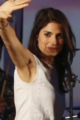 Virginia Raggi, of the 5-Star Movement, waves to supporters during a rally in Ostia, in the outskirts of Rome.