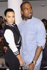 Slip of a smile: Kanye West (with wife Kim Kardashian) doesn't like smiling.