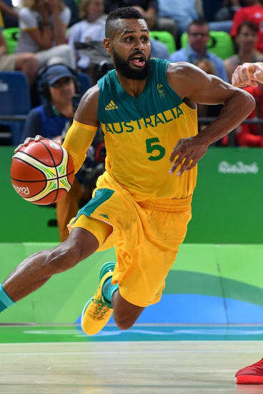 Top of their Games: Patty Mills drives forward for the Boomers.