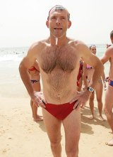 Mr Abbott in his trademark red budgie smugglers in 2015.