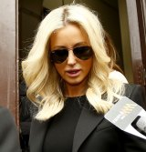 Oliver Curtis' wife Roxy Jacenko leaves court after her husband was sentenced to two years in prison, to be released after one year.