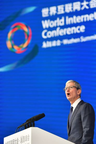 Apple's CEO Tim Cook delivers a speech at the opening ceremony of the Fourth World Internet Conference in Wuzhen town in Tongxiang.