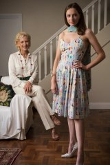 Charlotte Smith with her daughter Olivia modelling a dress made from pictures of all the dresses in her book.
