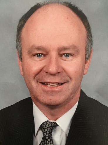 Work stress was believed to have contributed to the suicide of principal Mark Thompson.