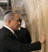 Israeli Prime Minister Benjamin Netanyahu touches the Western Wall in Jerusalem, after winning the general election on Wednesday.