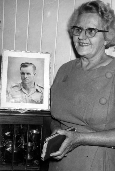 Thelma Healy, pictured holding her travel diary, with a photograph of her son, Vincent.