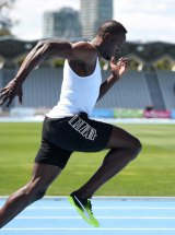 Striding out: Usain Bolt training at Lakeside Stadium.