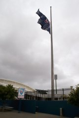 Mark of respect: The Australian flag is lowered to half mast at the Cricket NSW headquarters on Thursday afternoon.