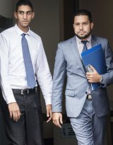 Mr Abdel Ghany, left, and his lawyer leave court.