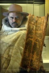 Gary Murray holding a famous and rare bark etching from Boort, Victoria.