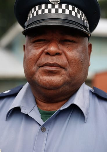 Manus Province police commander David Yapu, centre, said shots had been fired at the compound.