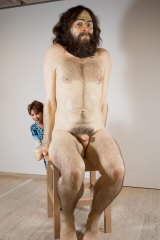 Kathy Lette with Ron Mueck's sculpture Wild Man in the AGNSW's Nude exhibition.
