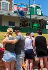 Locals grieve and pay their respects at Dreamworld.