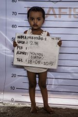 Norfouna, a Rohingya migrant child, poses for identification purposes at a temporary shelter in Indonesia.