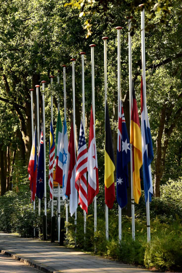 Flags from all the nations of the MH17 victims fly at half mast at the entrance to the military base in Hilversum.