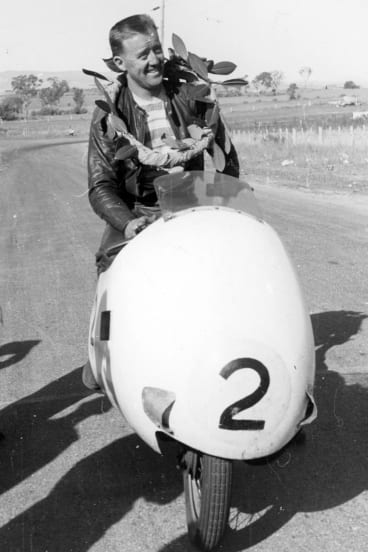 Jack Ahearn with the winner's garland after success at Bathurst in 1957.