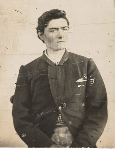 Sideshow Alley: Prison photograph of Ned Kelly c.1873, photographer unknown. Image courtesy of National Museum of Australia.
