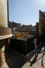 Academic and poet Keri Glastonbury, pictured, outside the old David Jones building, its brickwork exposed like an urban ruin.