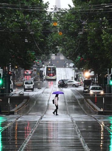 Rain hits Bourke Street.