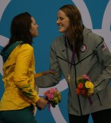 Different fates: Emily Seebohm and Missy Franklin share the dais.