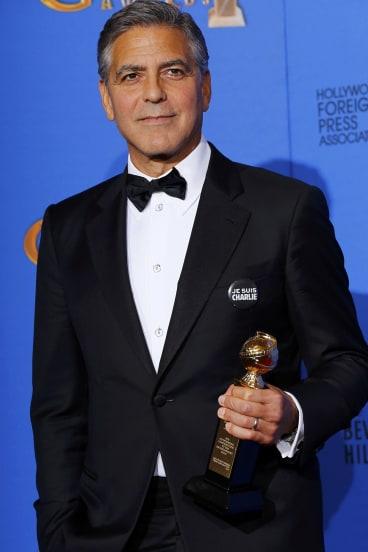 Raised up: George Clooney.