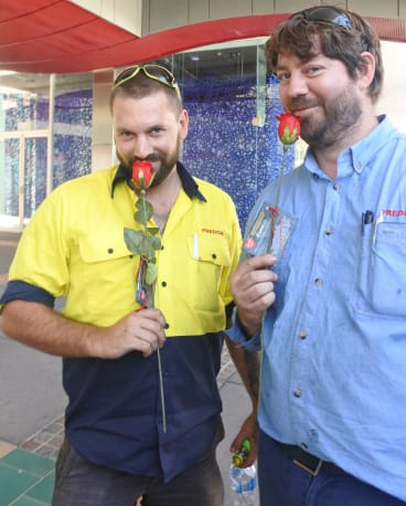 Dean Bissett and Scott Taylor were happy to receive a rose on Valentine's Day from Sexual Health and Family Planning ACT.