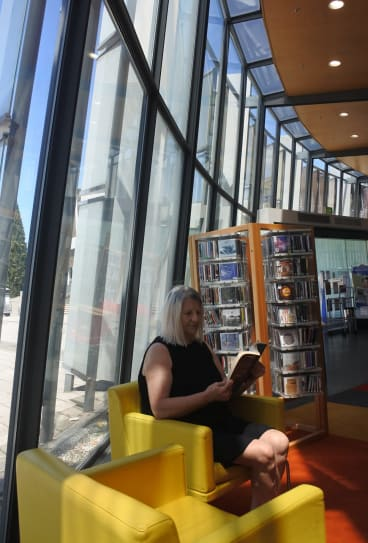 Mila Misic finds a quiet corner in the Civic library on Library Lovers Day on Wednesday.