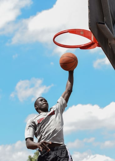 Deng Adel works on his game at a local basketball court in Fitzroy.