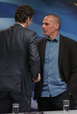 Dutch Finance Minister and Eurogroup President Jeroen Dijsselbloem, left, talks to Greece's Finance Minister Yanis Varoufakis after their meeting at the Finance Ministry in Athens.