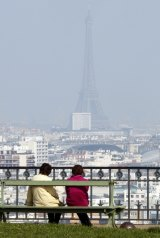 The Eiffel Tower disappears behind a blanket of small-particle haze caused by car fumes.