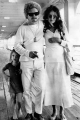 Brett, wife Wendy and daughter Arkie Whiteley arrive back in Sydney from Britain in 1969.