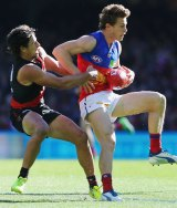 Mark Baguley of the Bombers tackles Ryan Lester.