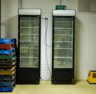 Freezers are being used to freeze books so they can be saved from the flood damage.