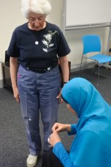 Stickers are put on  participant Judith Wimborne to help calibrate the video footage.