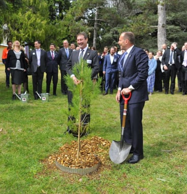 Prime Minister Tony Abbott plants a sapling with Ian Irving, chief executive for Australia, Northrop Grumman, at the launch of the Soldier On, Hand Up program.