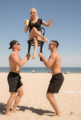 Balancing act: Cirque Du Soleil on Port Melbourne Beach.