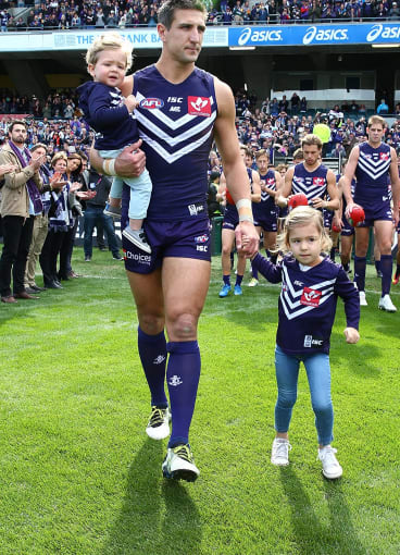 Matthew Pavlich makes his way onto the ground with children Jack and Harper.