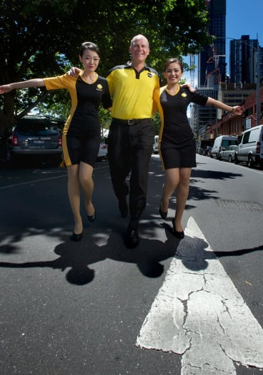 Runway models : Scoot airlines launches a route from Melbourne to Singapore with CEO Campbell Wilson with cabin crew Scha and Germin Chng.