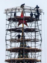 The nature of Russian news has changed. Pictured: workers stand on scaffolding erected around the top of the Spasskaya tower (Saviour Tower) of the Kremlin as it undergoes repair, in Moscow this month.