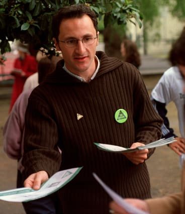 Richard Di Natale handing out how-to-vote cards at Errol Street Primary School in North Melbourne.