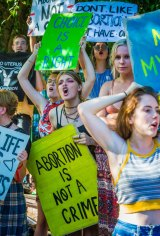 A small group of pro-choice demonstrators greeted the pro-lifers at Parliament House.