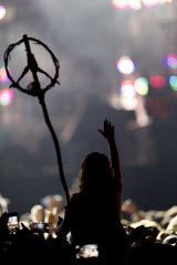 A concert-goer waves a peace symbol during Paul McCartney's show at the Firefly Music Festival in Dover, Delaware on Friday night.