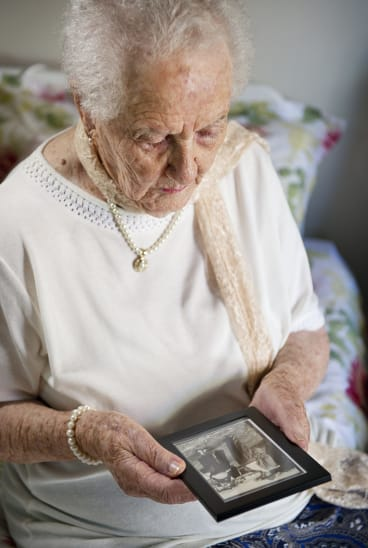 Evelyn Shirley with a photo of her late husband