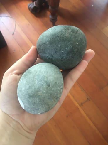 Brisbane resident Olivia Hill uploaded this photo of rocks thrown through her windows on Sunday night.
