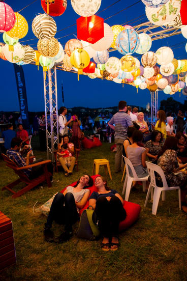 Thousands of Canberrans flocked to the Enlighten, Noodle Night Market to devour dumplings, noodles and Asian barbecue skewers.