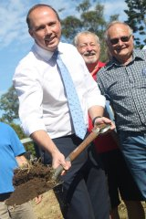 Peter Dutton at the official sod turning for a new men's shed in his electorate.