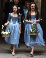 Chloe and Grace Helen Murdoch leave the Fleet Street church after the wedding ceremony.