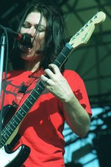 "Kim Deal on stage with the Breeders and ""pushing things forward""."