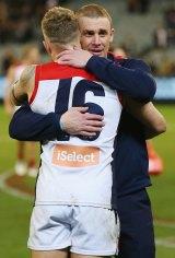 Good spirits: Demons coach Simon Goodwin congratulates Dean Kent after the win.