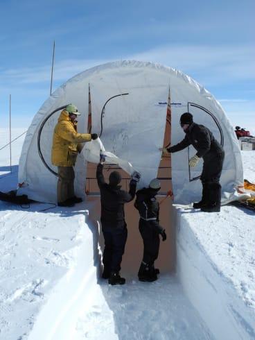 Erecting a drilling tent at Aurora Basin North.